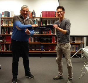 Club President, Peter Bird, and former club President, Phuc-An Tran, with the Founder's Award, which the club received.